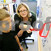 Rob Winner – rwinner@daily-chronicle.com<br /> <br /> Second grade teacher Pam Reilly, of Woodbury Elementary School in Sandwich, Ill., and her son Nolan Reilly, 8, use a magnetic white board during a punctuation lesson on Wednesday September 29, 2010. The white board was purchased by donations made through a website called DonorsChoose.org.