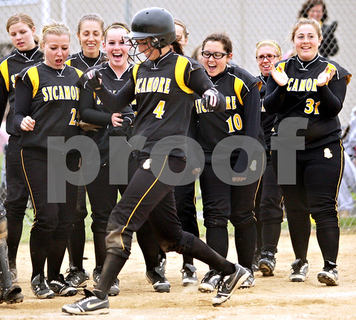 Beck Diefenbach  -  bdiefenbach@daily-chronicle.com<br /> <br /> Sycamore's Haley Salazar (4) is congratulated by teammates at home plate following her three-run home run during the third inning of the game against DeKalb at Sycamore High School in Sycamore, Ill., on Monday May 10, 2010.