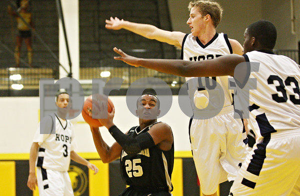 Rob Winner – rwinner@daily-chronicle.com<br /> <br /> Kaneland's Matt Cowans looks to take a shot but is blocked by Hope's Torrance Johnson (33) during the second quarter in Sycamore on Tuesday night. Hope went on to defeat Kaneland, 58-48.