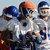 Rob Winner – rwinner@daily-chronicle.com<br /> <br /> Toby Canterbury carries the ball during the Cogs' morning practice on Thursday August 12, 2010 in Genoa, Ill.