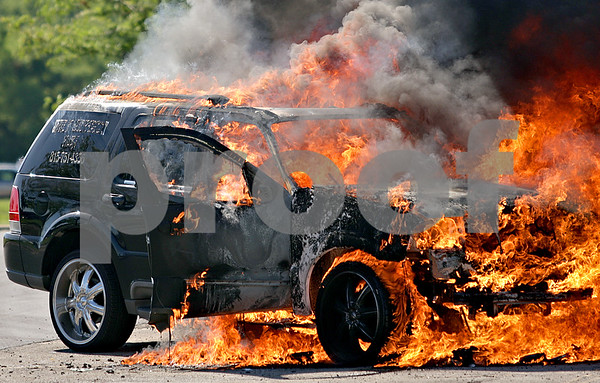 Beck Diefenbach  -  bdiefenbach@daily-chronicle.com<br /> <br /> A Lincoln Aviator sport utility vehicle owned by Angel Garcia, of DeKalb, is engulfed in flames in the Walmart parking lot in DeKalb, Ill., on Friday July 2, 2010.