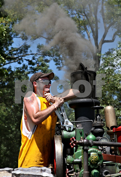 Rob Winner – rwinner@daily-chronicle.com<br /> <br /> Clayton Hendrickson, of Edgerton, Wisconsin, tightens the reverse block of a 1922 Minneapolis steam traction engine during the Sycamore Steam Show & Threshing Bee in Sycamore, Ill., on Thursday August 12, 2010.