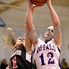 Beck Diefenbach  -  bdiefenbach@daily-chronicle.com<br /> <br /> Hinckley-Big Rock's Katie Hollis (12, right) grabs a rebound above Indian Creek's Gretchen Tyler (21) during the second half of the Little 10 Tournament semi-final game at H-BR in Hinckley, Ill., on Thursday Jan. 21, 2010. H-BR defeated Indian Creek 69 to 34.