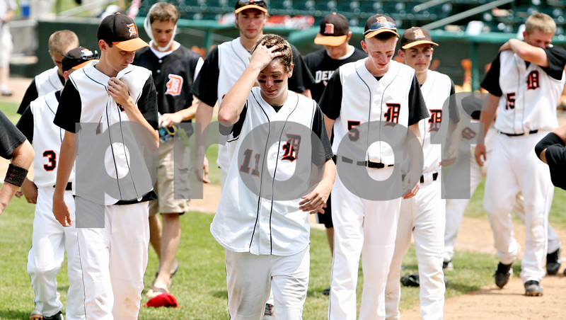 Rob Winner – rwinner@daily-chronicle.com <br /> <br /> The DeKalb Barbs leave the field after falling to Chatham Glenwood 11-1 in six innings during the IHSA Class 3A championship on Saturday June 12, 2010 in Joliet, Ill.