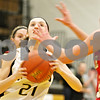 Rob Winner – rwinner@daily-chronicle.com<br /> <br /> Sycamore's Lauren Miller moves through Yorkville's defense on her way to the basket during the second quarter in Sycamore, Ill. on Tuesday December 7, 2010.