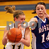 Beck Diefenbach  -  bdiefenbach@daily-chronicle.com<br /> <br /> Hinckley-Big Rock's Kaitlin Phillips (right) tries to swipe the ball from Stockton's Jessica Burnner (11, left) during the first quarter of the IHSA Class 1A Super Sectional championship game at Judson University in Elgin, Ill., on Monday Feb. 22, 2010.