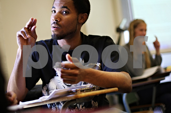 Beck Diefenbach  -  bdiefenbach@daily-chronicle.com<br /> <br /> Student Tim Harper talks in sign language with his small group during class in Wirtz Hall on the campus of Northern Illinois University in DeKalb, Ill., on Monday March 29, 2010.