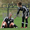 Beck Diefenbach  -  bdiefenbach@daily-chronicle.com<br /> <br /> Indian Creek's Carson Day (5, left) sits on the ground following an asthma attack during the second half of the game at Kaneland High School in Maple Park, Ill., on Wednesday April 7, 2010. Kaneland defeated Indian Creek 7 to 0.