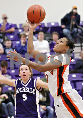 Beck Diefenbach  -  bdiefenbach@daily-chronicle.com<br /> <br /> DeKalb's Michelle Todd shoots the ball  during the second quarter of the IHSA Class 3A Regional game against Rochelle at Rochelle Township High School in Rochelle, Ill., on Wednesday Feb. 17, 2010