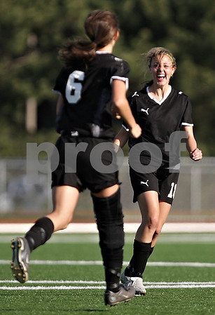 Beck Diefenbach  -  bdiefenbach@daily-chronicle.com<br /> <br /> Sycamore's Katelyn Brown (11, right) and Katie Bolander (6) celebrate after Brown's goal during the first half of the game at Northern Illinois University in DeKalb, Ill., on Thursday April 29, 2010. Sycamore defeated DeKalb 2 to 0.