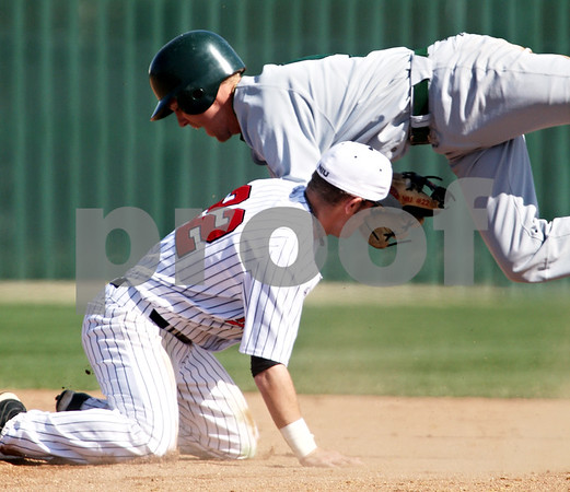 Beck Diefenbach  -  bdiefenbach@daily-chronicle.com<br /> <br /> Northern Illinois' Alex Beckmann (22) tags out Ohio's Zach Keen (5) at second base during the third inning of the game at NIU in DeKalb, Ill., on Friday April 16, 2010.