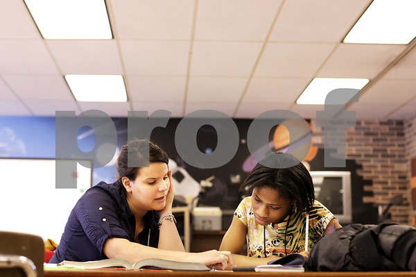 Beck Diefenbach  -  bdiefenbach@daily-chronicle.com<br /> <br /> DeKalb freshman Marquita Seals (right) gets help with her Algebra homework from Northern Illinois University student teacher Stefanie Gutierrez during the Student Tutors and Resources program at DeKalb High School on Wednesday Feb. 3, 2010.