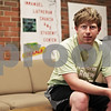 "Beck Diefenbach  -  bdiefenbach@daily-chronicle.com<br /> <br /> Northern Illinois University sophomore Andrew Wegner works as a peer minister at Immanuel Lutheran Church in DeKalb. Although the church's lounge is in need of new carpeting and furniture, he insists a relationship with God is always the real goal. ""As important as (the improvements) may be, God is the focus,"" he said."