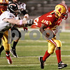 Kyle Bursaw - kbursaw@daily-chronicle.com<br /> <br /> DeKalb Linebacker Troy Talaga snags the jersey of Rock Island's Chris Glover during the first quarter of the Barb's first-round playoff game in Rock Island, Ill on Oct. 29, 2010.