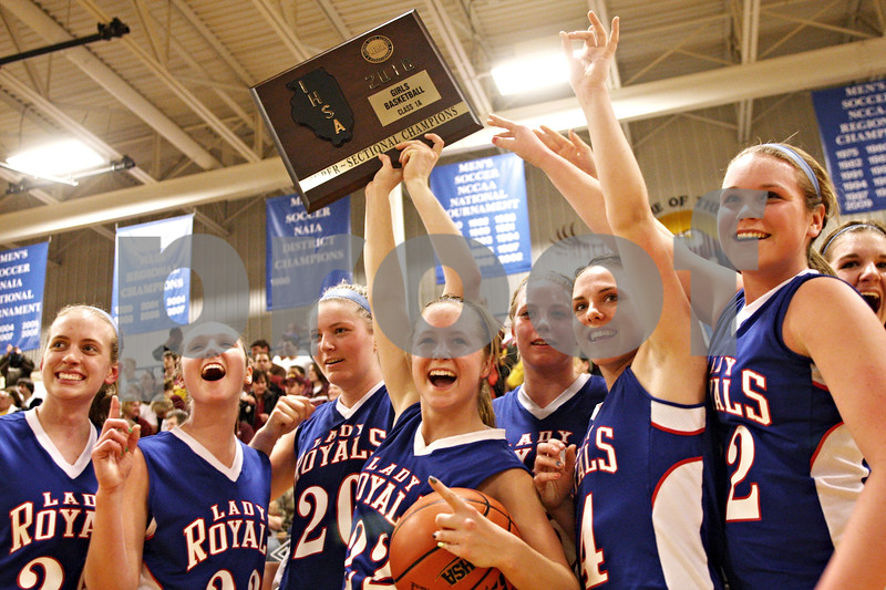 Beck Diefenbach - bdiefenbach@daily-chronicle.com<br /> <br /> (From left) Hinckley-Big Rock's Jessica Leifheit, Alyssa Baunach, Jenna Thorp, Maxzine Rossler, Jess Meyer, Kaitlin Phillips, Katie Hollis and Tess Godhardt celebrate after defeating Stockton to win the IHSA Class 1A Super Sectional championship game at Judson University in Elgin, Ill., on Monday Feb. 22, 2010.