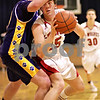 Beck Diefenbach  -  bdiefenbach@daily-chronicle.com<br /> <br /> Indian Creek's Seth Sanderson (25) attempts to get around Paw Paw's Heath Nicholson (30) during the first quarter of the Little Ten Tournament first round game at Somonaulk High School in Somonaulk, Ill., on Monday Feb. 1, 2010.