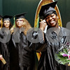 Rob Winner – rwinner@daily-chronicle.com<br /> <br /> Tawanna Ellison is all smiles as she heads to the stage to receive her diploma during the Kishwaukee College commencement ceremony on Saturday May 15, 2010 in Malta, Ill. Ellison finished with an associate of science degree.