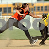 Beck Diefenbach  -  bdiefenbach@daily-chronicle.com<br /> <br /> DeKalb's Kelli Gerace (18, left) tags out Sycamore's Samantha Navarro (8, right) after getting stuck in a pickle during the second inning of the IHSA Class 2A Regional semi final game at Sycamore High School in Sycamore, Ill., on May 27, 2010.