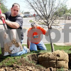 Rob Winner – rwinner@daily-chronicle.com<br /> <br /> Chad Knutson (left) and his father Gary Knutson, of Knutson Lawn Care, plant one of seven trees near the intersection of Industrial Drive and Lincoln Highway in DeKalb, Ill. on Thursday April 22, 2010.