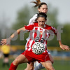 Rob Winner – rwinner@daily-chronicle.com<br /> <br /> Batavia's Bre Choffin (front) controls a ball in front of Sycamore's Katelyn Brown during the first half on Thursday April 22, 2010 in Sycamore, Ill. Batavia went on to defeat Sycamore, 2-0.