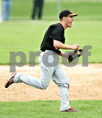Beck Diefenbach  -  bdiefenbach@daily-chronicle.com<br /> <br /> DeKalb's Kevin Sullivan (6, left) reacts after making the out to defeat Geneva at Geneva High School in Geneva, Ill., on Thursday May 13, 2010. DeKalb defeated Geneva 5 to 3.