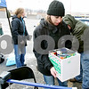 Rob Winner – rwinner@daily-chronicle.com<br /> <br /> Donations of food are dropped off at the WLBK 1360 Freezin' for Food drive on Wednesday in DeKalb.