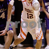 Beck Diefenbach  -  bdiefenbach@daily-chronicle.com<br /> <br /> DeKalb's Dylan Donnelly (12) steals the ball from Rochelle's Seth Anderson (14) during the second quarter of the game at DeKalb High School  in DeKalb, Ill., on Friday Jan. 8, 2010.