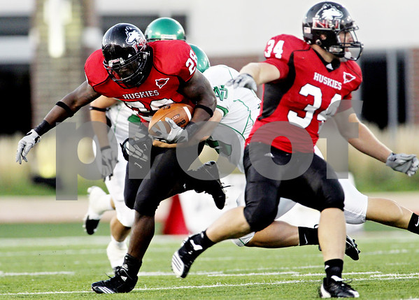 Rob Winner – rwinner@daily-chronicle.com<br /> <br /> Northern Illinois running back Chad Spann carries the ball during the second quarter in DeKalb, Ill. on Saturday September 11, 2010. Northern Illinois went on to defeat North Dakota, 23-17.
