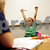 "Beck Diefenbach  -  bdiefenbach@daily-chronicle.com<br /> <br /> Jahmir Mojica, 5, reacts after correctly writing the letter ""G"" during a reading and writing tutoring session with Lauren Olson (left) at the Northern Illinois University Literacy Clinic in DeKalb, Ill., on Wednesday July 14, 2010."
