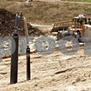 Beck Diefenbach  -  bdiefenbach@daily-chronicle.com<br /> <br /> One of many gas recovery wells stands above the active landfill at Waste Management in Cortland, Ill., on Monday April 5, 2010. The gas recovery well helps reduce odor and seepage from the landfill by creating a negative pressure in the soil with the removal of the gas which is burned.