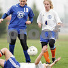 Beck Diefenbach  -  bdiefenbach@daily-chronicle.com<br /> <br /> Galena/River Ridge's Jessie Albrecht (10, left) and Genoa-Kingston's Vanessa Quandt (4, right) watch as G-K's Shannon Schumacher (28) falls to the ground during the first half of the game at G-K High School in Genoa, Ill., on Tuesday May 11, 2010. G-K defeated Galena/River Ridge 8 to 1.