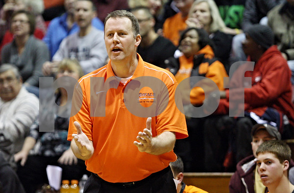 Rob Winner – rwinner@daily-chronicle.com<br /> <br /> DeKalb coach David Rohlman asks about a foul called on his team during second quarter in DeKalb, Ill. on Friday December 17, 2010. Kaneland defeated DeKalb in the final seconds, 49-47.