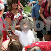 Beck Diefenbach  -  bdiefenbach@daily-chronicle.com<br /> <br /> Aubrie McSwain, 7, of Lee, finishes in the ice cream eating contest during Fourth of July festivities in Shabbona, Ill., on Sunday.