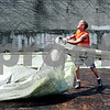 Rob Winner – rwinner@daily-chronicle.com<br /> <br /> Robin Zander of the DeKalb Public Works tears off a plastic liner as workers dismantled the skating rink in DeKalb, Ill. at First and Locust streets on Thursday July 15, 2010.