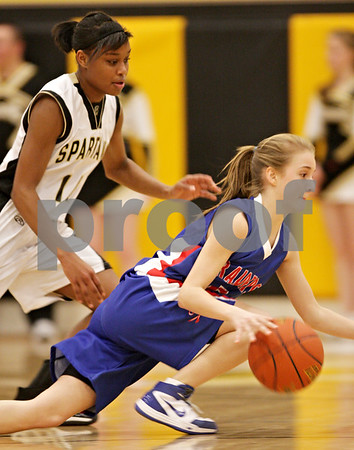 Beck Diefenbach  -  bdiefenbach@daily-chronicle.com<br /> <br /> Sycamore's Lake Kwaza (left) follows Glenbard South's Elisa Anderson (right) as she falls to the ground during the first quarter of the game at Sycamore High School in Sycamore, Ill., on Tuesday Feb. 2, 2010.