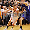 Beck Diefenbach  -  bdiefenbach@daily-chronicle.com<br /> <br /> DeKalb's Pat Rourke (25, left) dribbles the ball around Geneva Dan Trimble (25) during the third quarter of the game at DeKalb High School, in DeKalb, Ill., on Friday Jan. 5, 2010. DeKalb defeated Geneva 55 to 52.