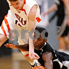 Beck Diefenbach - bdiefenbach@daily-chronicle.com<br /> <br /> Kaneland's Donavan Williams (24, right) and DeKalb's Dylan Donnelly (12) battle for a loose ball during the third quarter of the IHSA Class 3A Regional championship game at Kaneland High School in Maple Park, Ill., on Friday March 3, 2010.