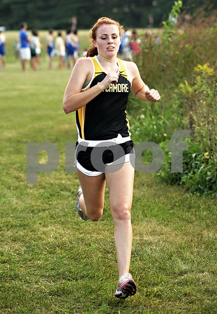 Beck Diefenbach  -  bdiefenbach@daily-chronicle.com<br /> <br /> Sycamore's Tess Strack crosses the finish line at the Sycamore Invitational event at Kishwuakee Community College in Malta, Ill., on Tuesday Aug. 31, 2010.