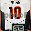 Rob Winner – rwinner@daily-chronicle.com<br /> <br /> Nicole Ohme of Black Iris Gallery in Sandwich has created a shadow box for injured Sandwich football player Connor Voss featuring his jersey, achievements and photographs.