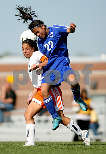 Beck Diefenbach  -  bdiefenbach@daily-chronicle.com<br /> <br /> DeKalb's Jassmine Marquez (3, left) and Burlington Central's Camille Dela Cruz (22) leap to head the ball during the first half of the game at Rochelle Township High School in Rochelle, Ill., on Tuesday May 18, 2010. DeKalb defeated Burlington Central 4 to 2.