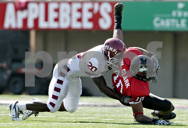 Rob Winner - rwinner@daily-chronicle.com<br /> <br /> Northern Illinois wide receiver Willie Clark (10) is tackled by Temple's Kee-ayre Griffin after a reception in the third quarter of their game in DeKalb, Ill. on Saturday October 9, 2010. The Huskies went on to defeat Temple, 31-17.