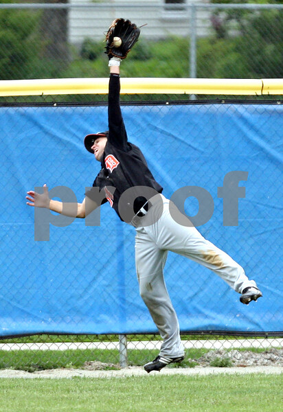 Beck Diefenbach  -  bdiefenbach@daily-chronicle.com<br /> <br /> DeKalb's Frank Petras (14) makes a leaping catch during the sixth inning of the game against Geneva at Geneva High School in Geneva, Ill., on Thursday May 13, 2010. DeKalb defeated Geneva 5 to 3.