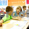 Rob Winner – rwinner@daily-chronicle.com<br /> <br /> Second grade students including Hunter Wilson (left), 7, and JoAnna Smolla, 7, work on a puzzle as the first day of school at Malta Elementary School begins in Malta, Ill. on Monday August 23, 2010. This was the last first day of school for Malta Elementary School which will be closed at the end of the academic year.