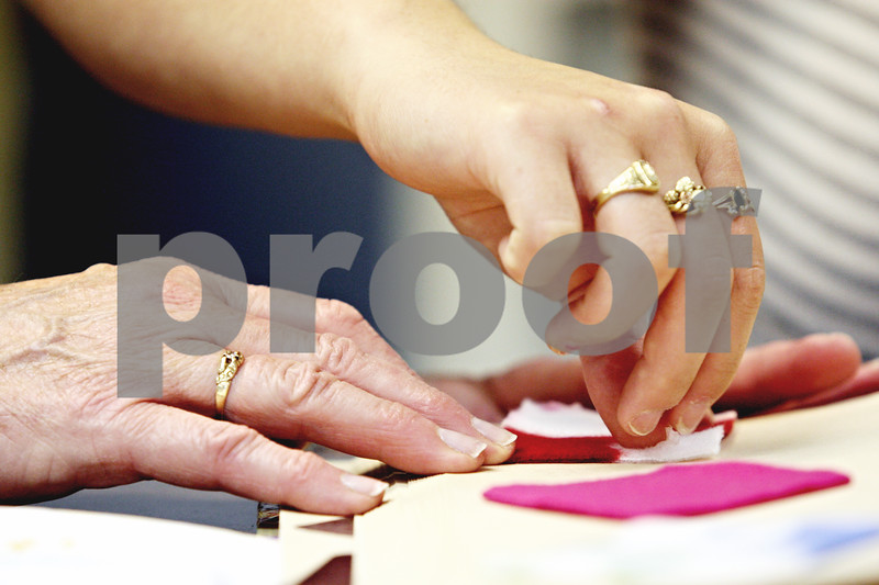 Rob Winner – rwinner@daily-chronicle.com<br /> <br /> Karen Orser and Desiree C. glue items into their scrapbook at the Family Service Agency in DeKalb, Ill. on Thursday May 20, 2010. The pair have been together for 12 years.<br /> <br /> *Check Carrie's story for Desiree's last name. They would not give it to me on the day I met with them. - Rob