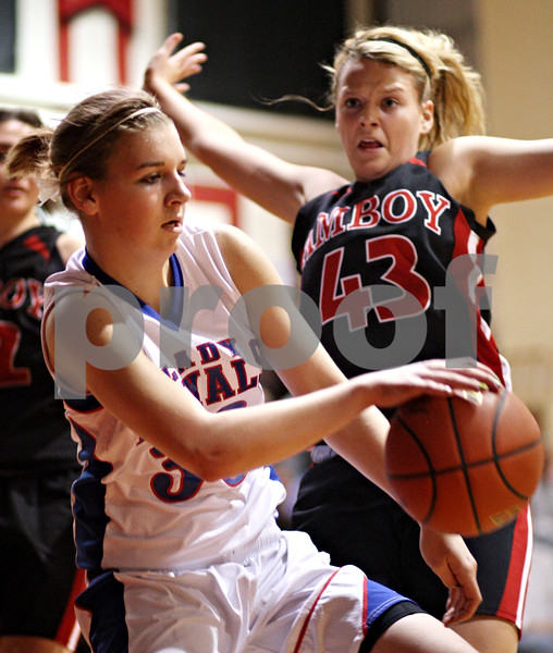 Beck Diefenbach – bdiefenbach@daily-chronicle.com<br /> <br /> Hinckley-Big Rock's Tess Godhardt (left)dribbles past Amboy's Ashley Ferguson (43) during the first quarter of the IHSA Class 1A Regional Final game at Indian Creek High School in Shabbona, Ill., on Thursday Feb 11, 2010.