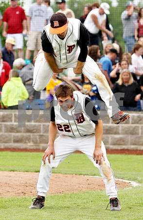 Rob Winner – rwinner@daily-chronicle.com<br /> <br /> Kevin Sullivan (top) leaps over DeKalb teammate Brian Sissler at the end of the IHSA Class 3A Augustana College Super-Sectional on Monday June 7, 2010. DeKalb defeated Galesburg, 8-4.