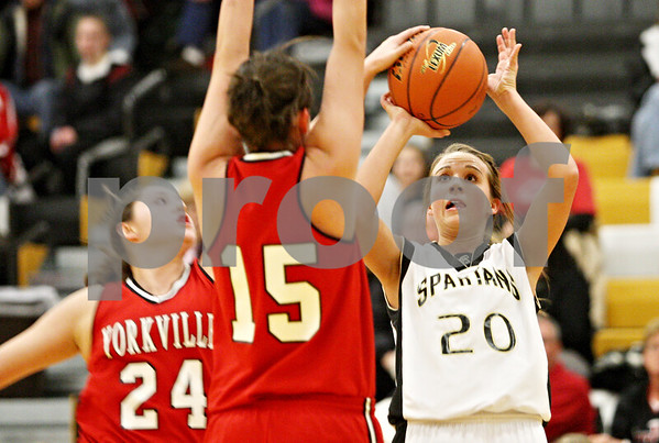 Rob Winner – rwinner@daily-chronicle.com<br /> <br /> Sycamore's Ashley Berlinski (20) takes a shot but is blocked by Yorkville guard Jenny Taptich (24) during the first quarter in Sycamore, Ill. on Tuesday December 7, 2010.