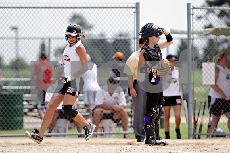 Rob Winner – rwinner@daily-chronicle.com<br /> <br /> Kishwaukee Valley Storm base runner Kelli Gerace (28) scores in the second inning of their game against the McHenry County Heatwave Black  during their 16U bracket game of the Storm Dayz softball tournament on Saturday June 26, 2010 in Sycamore, Ill.