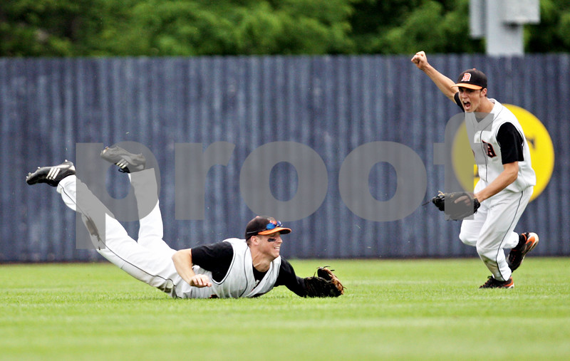 Rob Winner – rwinner@daily-chronicle.com<br /> <br /> Frank Petras (left) makes a diving catch to end the fourth inning as his teammate Brian Sisler reacts to the sensational grab during the IHSA Class 3A Augustana College Super-Sectional on Monday June 7, 2010. DeKalb defeated Galesburg, 8-4.