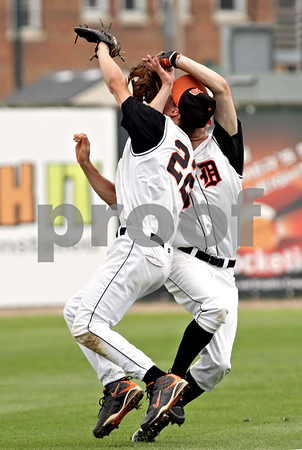 Beck Diefenbach  -  bdiefenbach@daily-chronicle.com<br /> <br /> DeKalb's Brian Sisler (left) and Jake Gordon collide after pursuing a fly ball during the first inning of the IHSA Class 3A State Semifinal Game against Marian Central in Joliet, Ill., on Friday June 11, 2010.